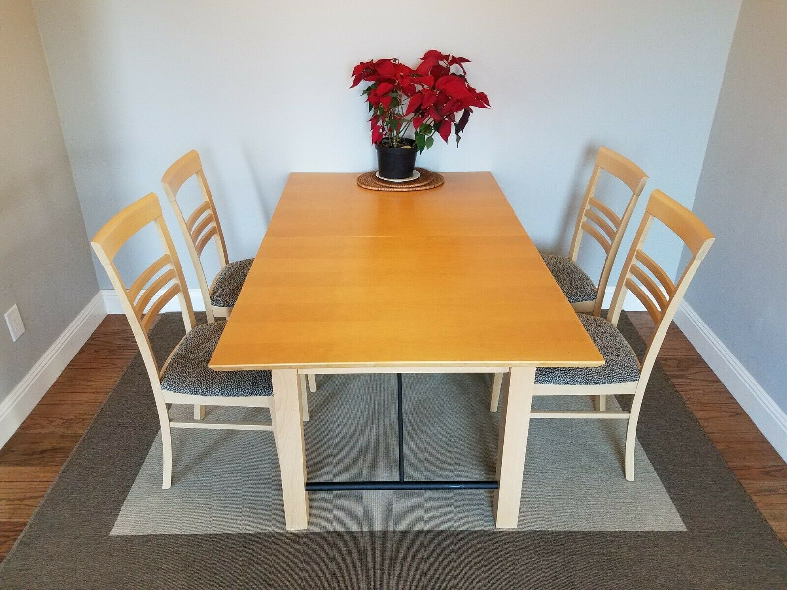 contemporary euro style dining table with 4 chairs and 2 leaves