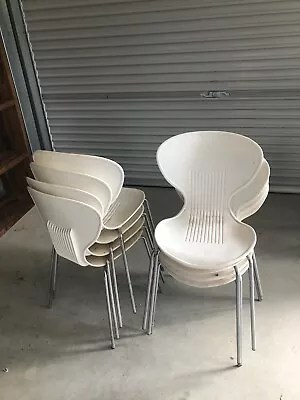 plastic chairs with stainless steel legs modern brown leather armchair designer dining gumtree australia caloundra
