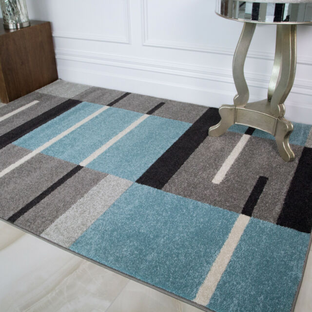 teal living room rug ideas with wooden walls modern blue grey patchwork for soft geometric black white squares design floor