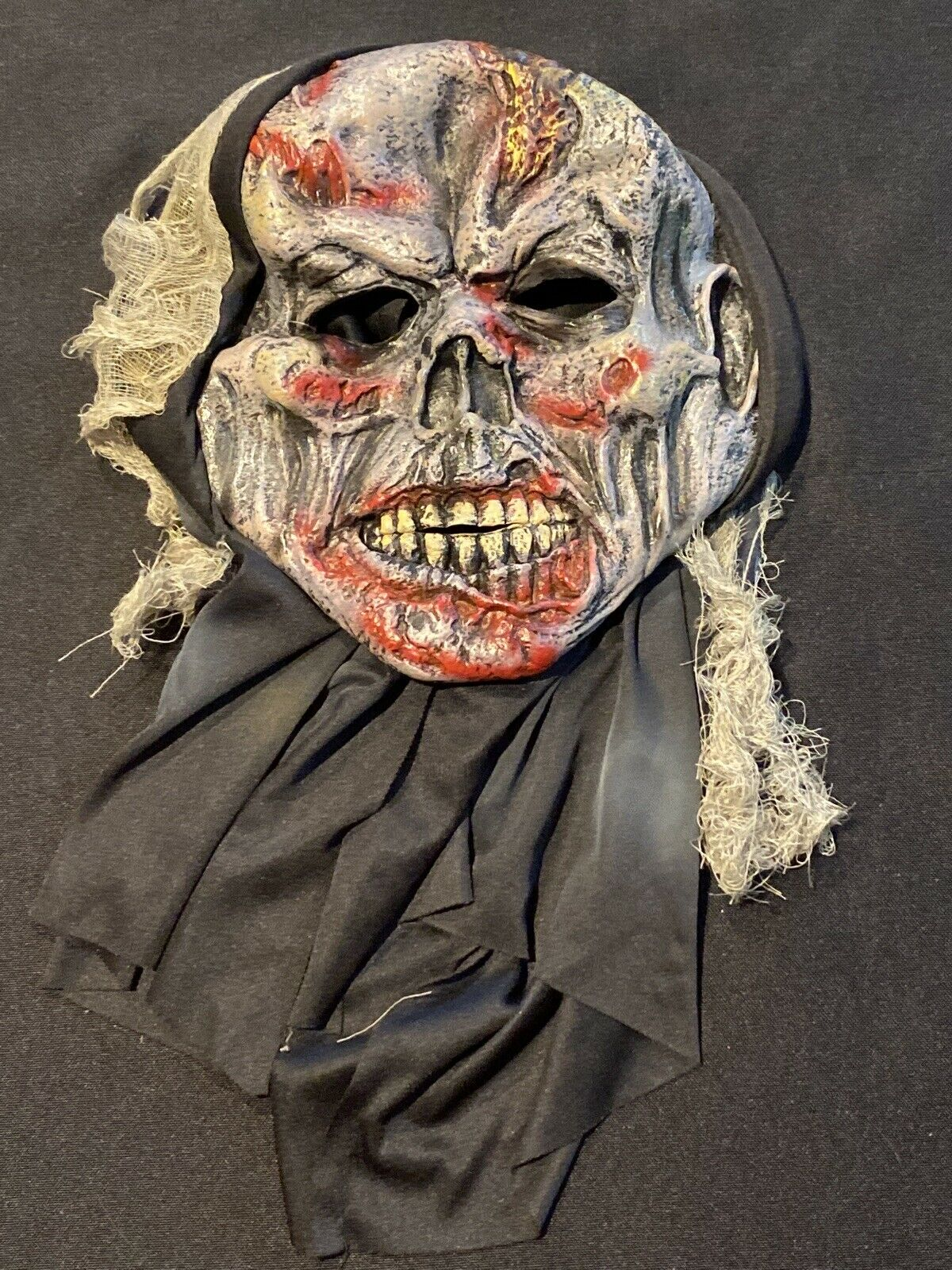 This quick history lesson will help you understand how this festive holiday began. Bloody Zombie Ghoul Creepy Mask Adult Scary Halloween Gem