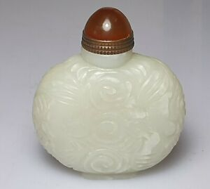 A Fine Late Qing Dynasty Carved White Jade Snuff Bottle.