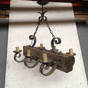 lustre rustique bois plus fonte de fer