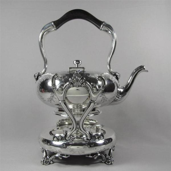 Tipping Teapot Antique Silver Plate Floral Design
