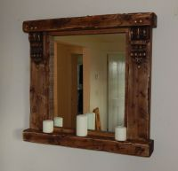 Large rustic wooden mirror with shelf and corbels