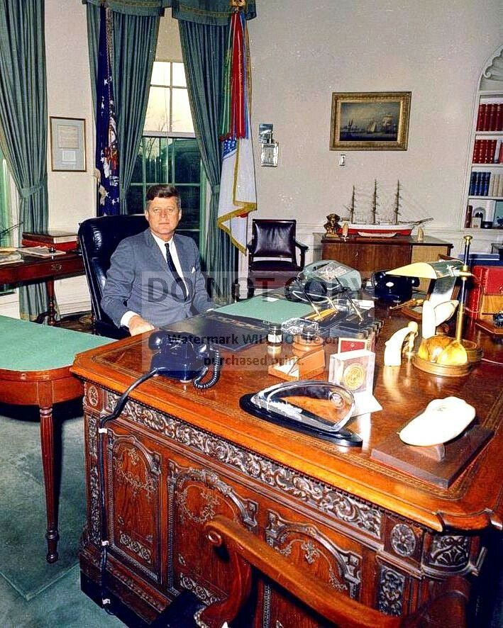 PRESIDENT JOHN F KENNEDY SITS AT THE RESOLUTE DESK