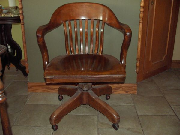 wooden office desk chairs AN ORIGINAL ANTIQUE 1900's WOODEN/SWIVEL BANKERS CHAIR