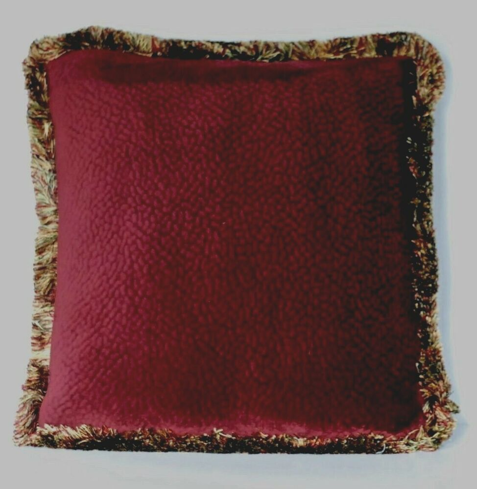 solid burgundy velvet decorative throw pillow with fringe