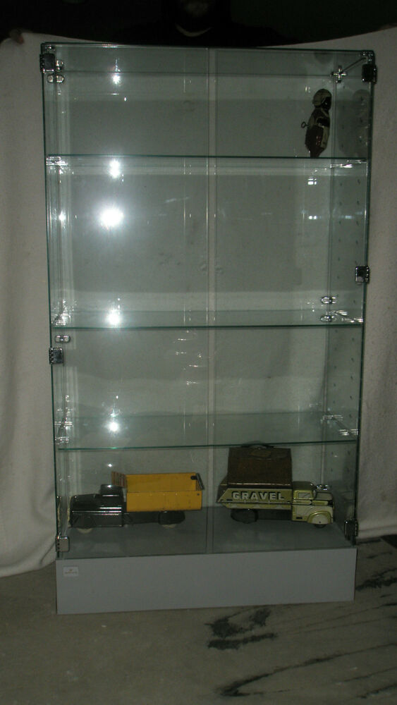 HALLMARK GLASS DISPLAY CASE 56 INCHES TALL wbase