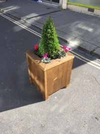 Wooden planter trough.