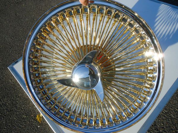 Gold Dayton Rims Cadillac