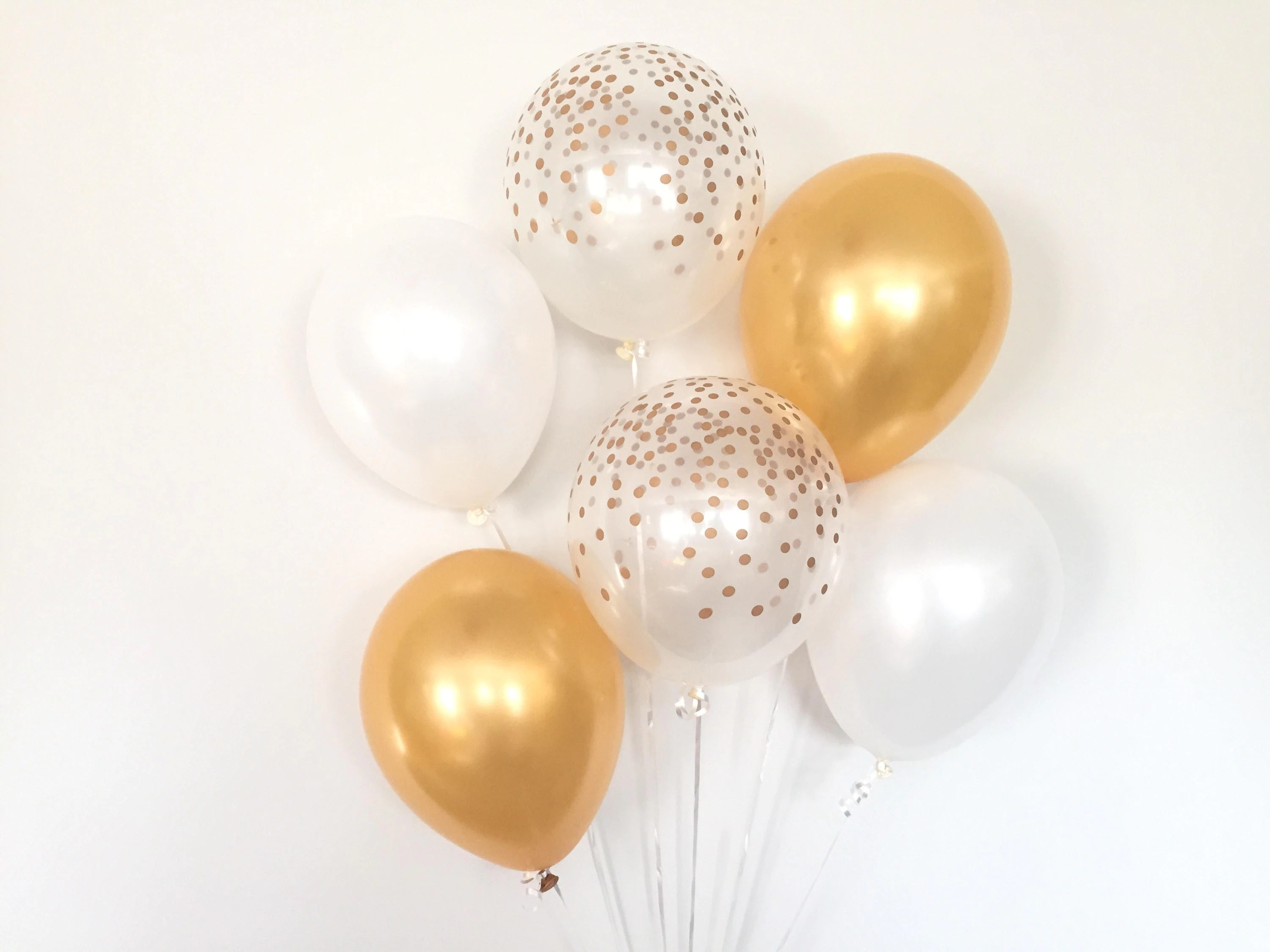 white and gold balloons