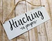 Hinching in progress Door Plaque Hanger