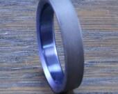 Anodized sandblasted titanium ring.