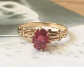 Solitaire Oval Garnet Engagement Ring 8 x 6, 10K Rose...read more