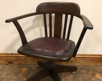 swivel chair em portugues desk recliner retro etsy early 20th century oak office with leather seat