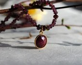 Garnet gemstone necklace with ruby pendant, January birthstone