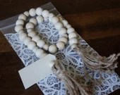 Wooden bead Garland with twine tassels and wooden tag