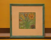 Framed metal flowers