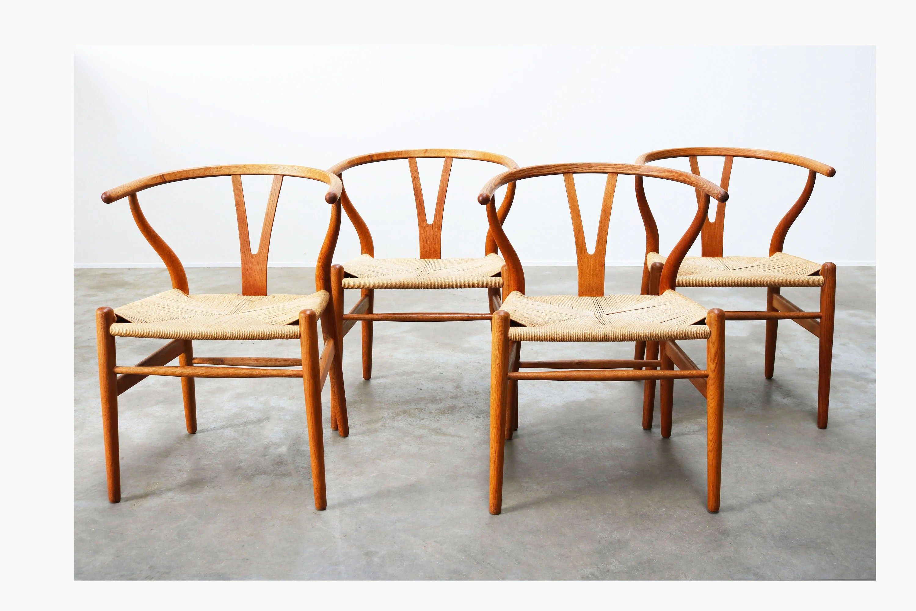 Wishbone Chairs Set Of Four Ch24 Wishbone Chairs By Hans J Wegner Oak Papercord Produced By Carl Hansen Son 1960s