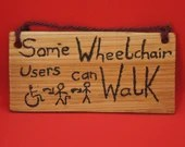 Some wheelchair users can walk sign - small
