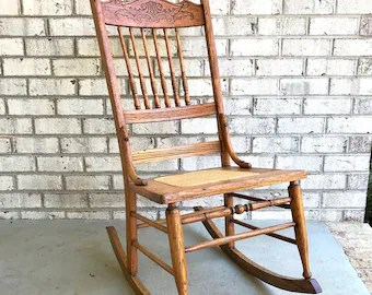 rocking chair cane gym chairs cost etsy antique solid wood bottom oak carved spindle pressed back rocker
