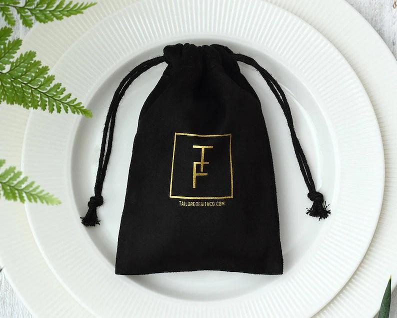 50 black flannel bags