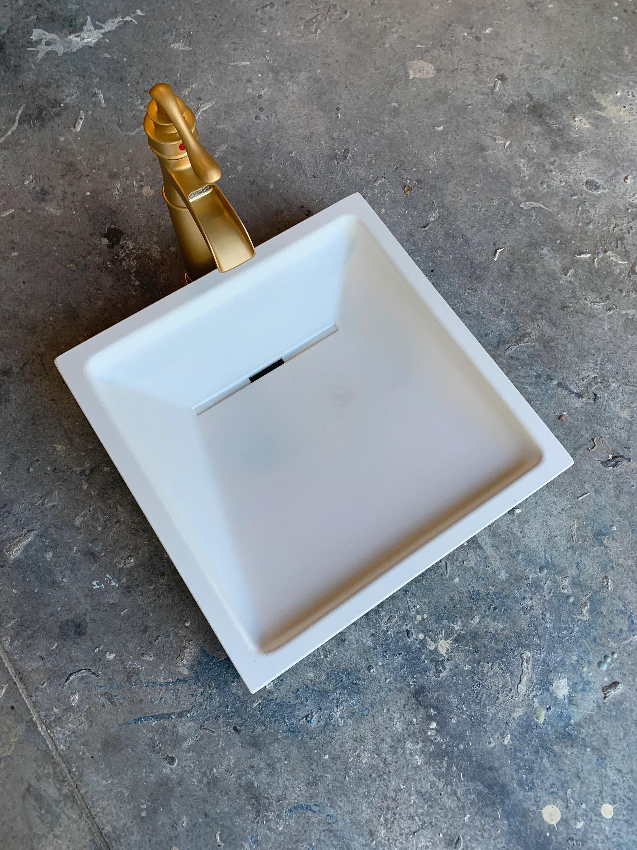 white concrete slot drain ramp sink