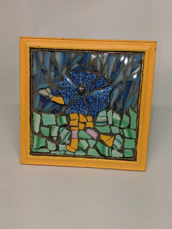 Mosaic framed art- girl in yellow rain slicker- mosaic umbrella girl- mosaic in the rain- dancing in the rain mosaic- yellow and blue art