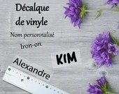 Custom iron-on vinyl decal with your name, for installation on iron fabrics.
