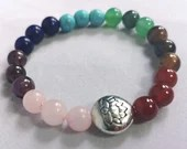 Rainbow chakra stone bracelet with lotus flower charm, bracelet with elastic bead. Jewelry. Multicolored