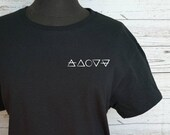 Black T-shirt with minimalist white vinyl decal with symbol elements, short sleeve sweaters.