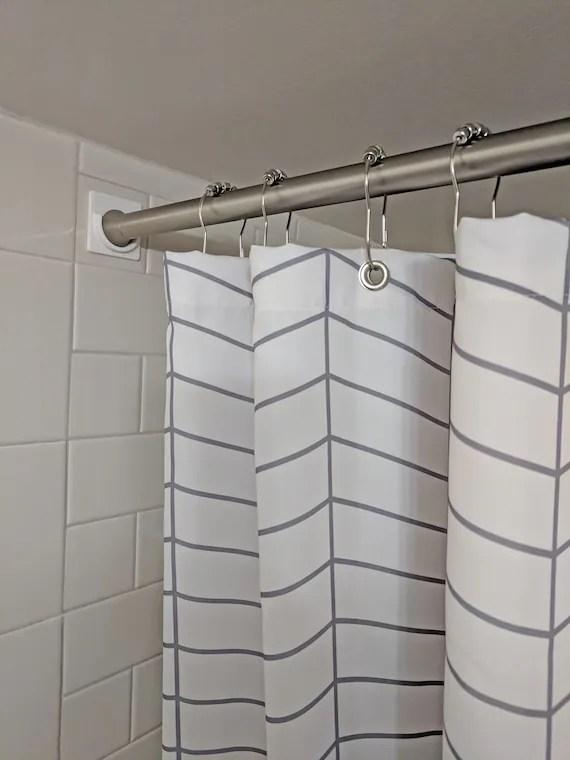 stick on shower curtain rod holder