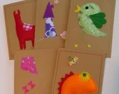 A set of 5 beautiful, unique handmade 3D cards, message me your selection. Made from material, felt, wooden buttons and recycled card.