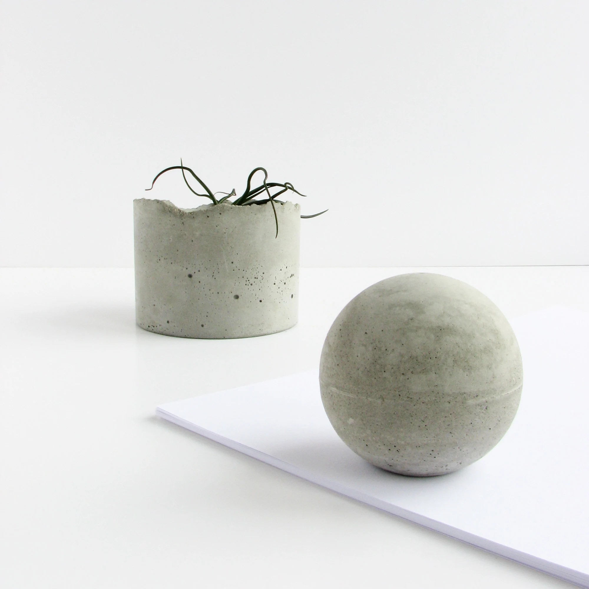 concrete paper weight sphere