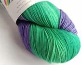 Self Striping sock yarn, hand dyed 75/25% superwash wool/nylon, fingering, 4-ply. Green and violet self-striping yarn.