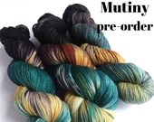 Hand dyed yarn pre-order.  Mutiny colourway. Variegated wool yarn dyed to order. Black, teal, gold and dark brown yarn.