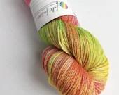 Hand dyed yarn, 100g of silver sparkle sock yarn, superwash merino/lurex 4ply/fingering. Fruit Salad yarn - pink, orange, yellow and green.