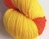 Self Striping sock yarn, hand dyed 75/25% superwash wool/nylon, fingering, 4-ply. Orange and yellow self-striping yarn in a long skein.