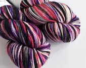 Hand dyed worsted weight wool yarn. The Knight Bus, worsted superwash merino wool, variegated red, purple, black and white indie dyed yarn.