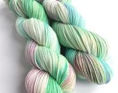 Hand dyed variegated 75/25% superwash merino/nylon sock fingering 4ply weight yarn.  Indie dyed green, blue and pink sock yarn.