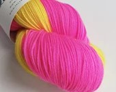 Self Striping sock yarn, hand dyed 75/25% superwash wool/nylon, fingering, 4-ply. Neon pink and yellow self-striping yarn in a long skein.
