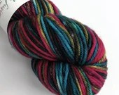 Hand dyed superwash merino worsted weight wool yarn. Bed Behaviour variegated rainbow and black wool yarn for knitting or crochet.
