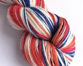 Hand dyed superwash BFL/silk 4ply/fingering weight yarn. Howard TBBT - red, orange, blue and white astronaut colours.