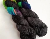 Hand dyed superwash merino dk yarn. Variegated double knit wool yarn, Grumpy Unicorn, black semi-solid yarn with rainbow, merino dk yarn.