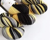 Hand dyed superwash merino/nylon dk wool, variegated double knit. Black, grey and yellow, thick sock yarn, double knit wool nylon blend yarn