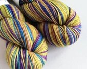 Hand dyed MCN sock yarn, superwash merino/cashmere/nylon 4ply/fingering wool yarn. Raj, variegated golden yellow, green, blue, purple yarn.