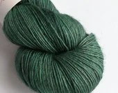 Hand dyed single ply superwash merino/yak/silk blend 4ply/fingering weight yarn.  Muted teal green on 4ply/fingering weight.
