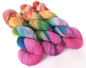 Hand dyed high twist superwash merino/nylon sock weight/fingering/4ply yarn. Variegated pink rainbow.  Summer Is Coming.