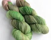 Hand dyed alpaca sock yarn,  60/20/20% superwash merino/superfine alpaca/nylon sock weight fingering 4ply yarn.  Rhubarb, greens and pinks.