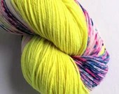 Self-striping hand dyed 75/25% superwash wool/nylon sock weight yarn, fingering, 4-ply. Neon yellow and speckled stripe yarn, long skein.